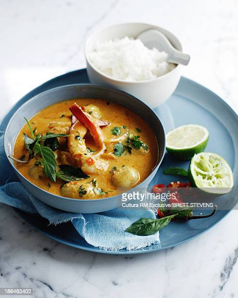 Bowl of prawn and potato curry with white rice
