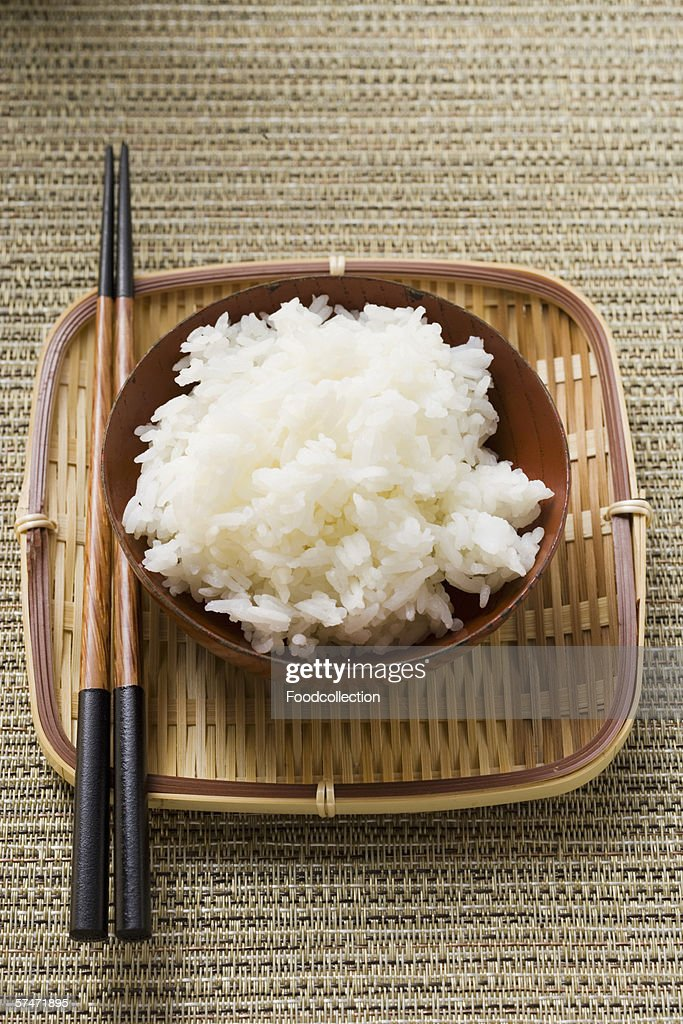 Bowl of rice and chopsticks on tray : Stock Photo