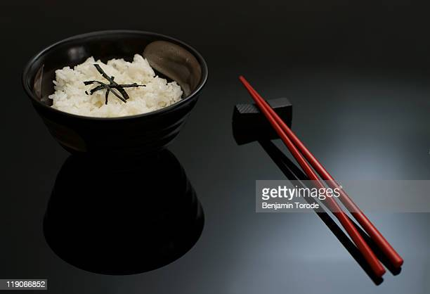 Bowl of rice and chopsticks