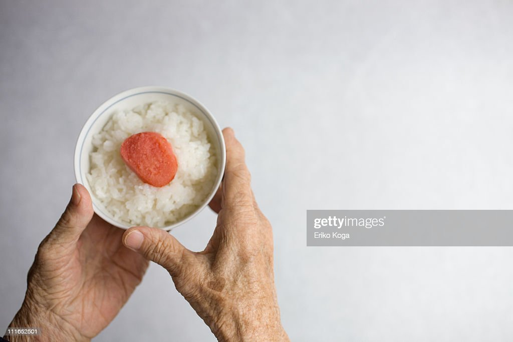 Bowl of rice in Hand : Stock Photo