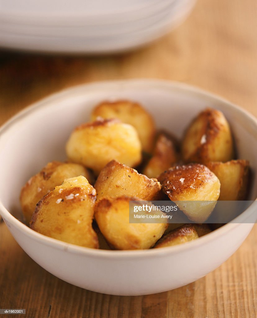 Bowl of Roast Potatoes : Stock Photo
