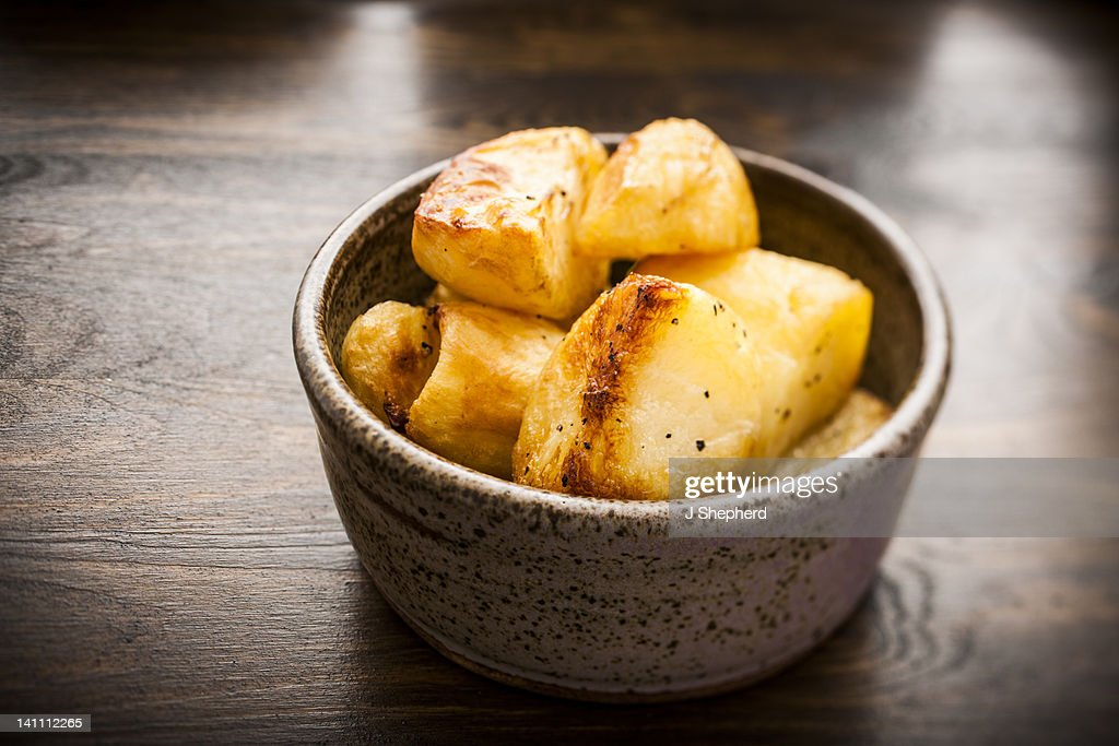 Bowl of roasted potatoes : Stock Photo