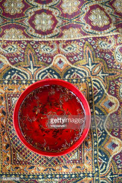 Bowl of rooibos tea on cloth