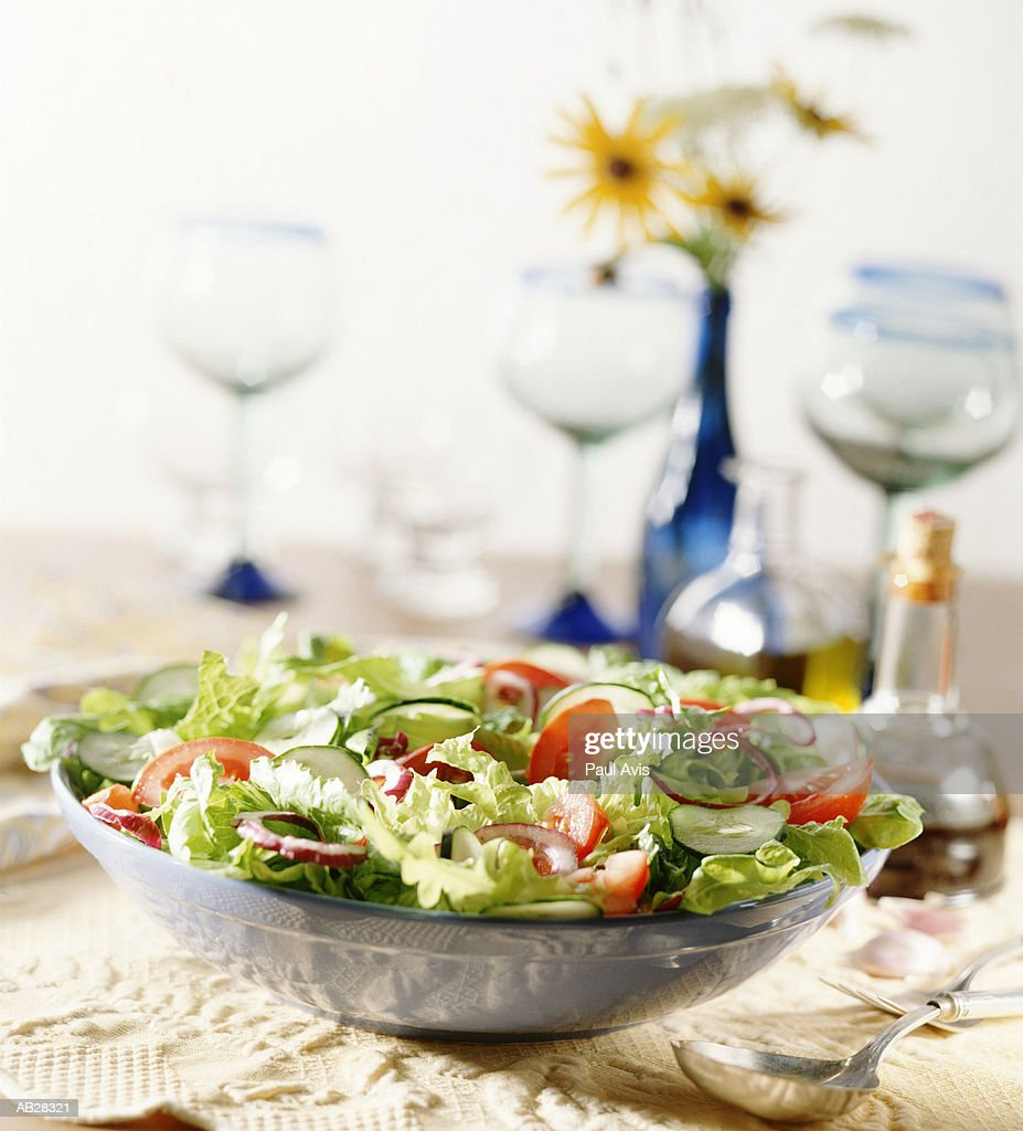 Bowl of salad on table : Stock Photo