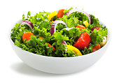 This is a photo of a white bowl of fresh salad. The background is a pure white allowing for endless copy.