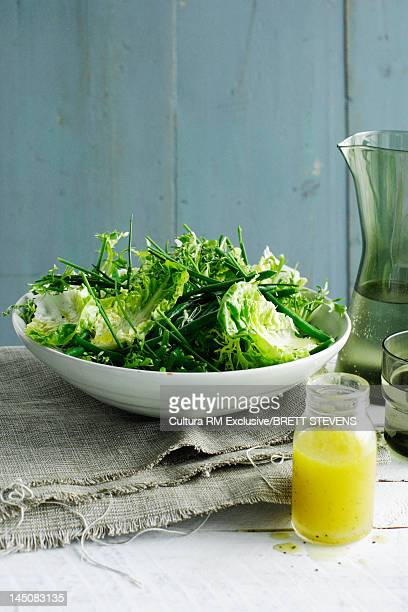 Bowl of salad with dressing