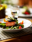 Bowl of salad with salmon and roasted vegetables