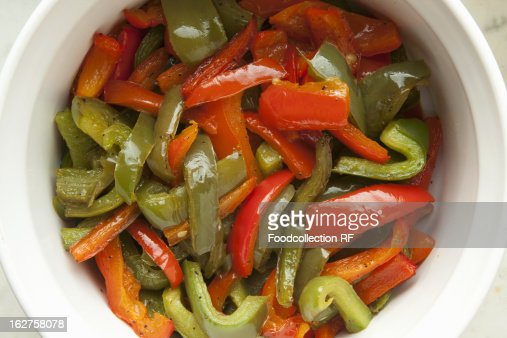 Bowl of sauteed red and green bell peppers