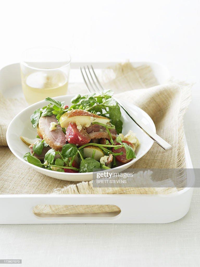 Bowl of smoked duck salad