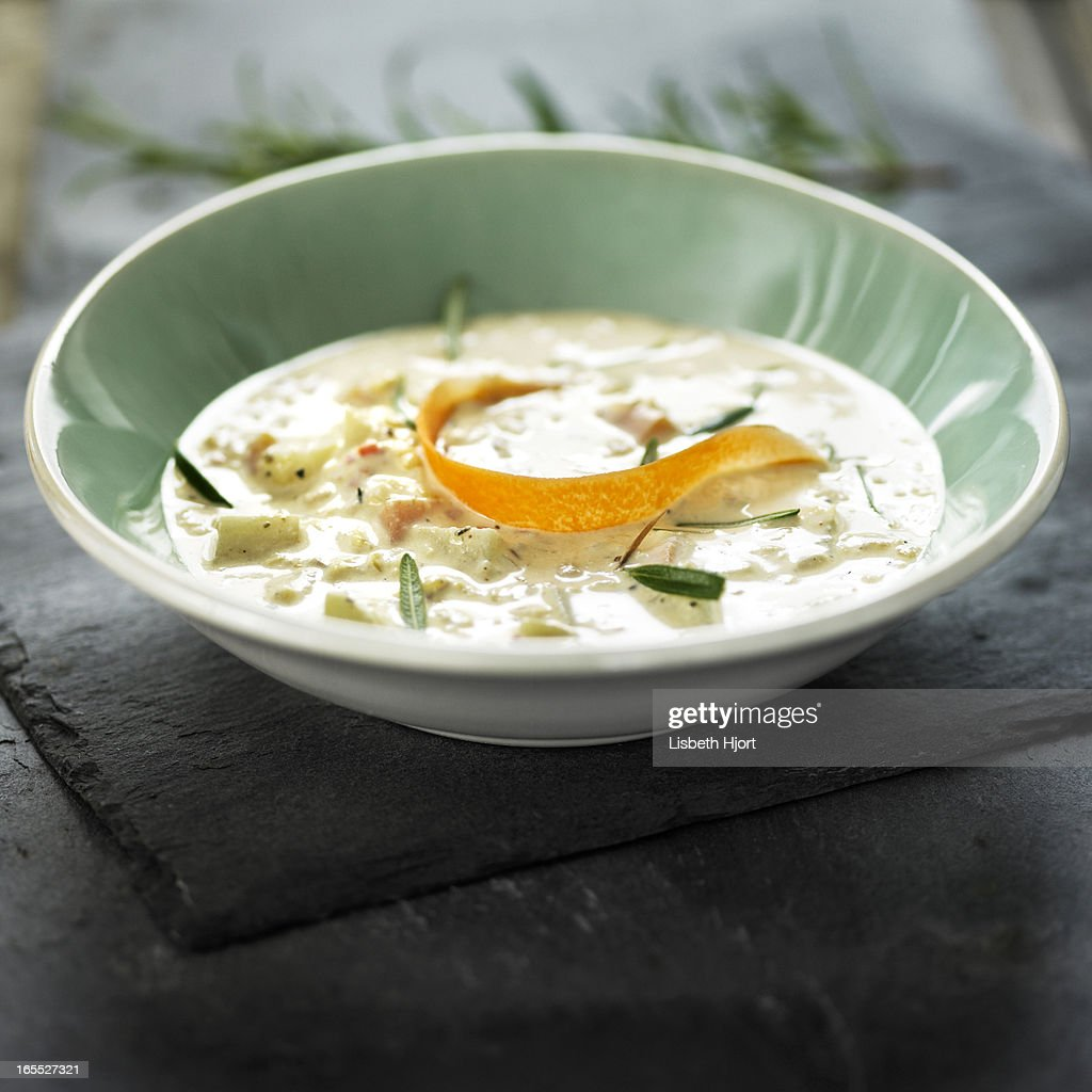 Bowl of soup with citrus peel