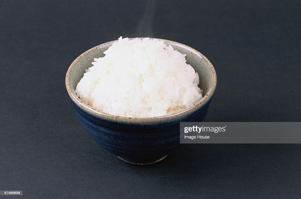 Bowl of steaming white rice : Stock Photo