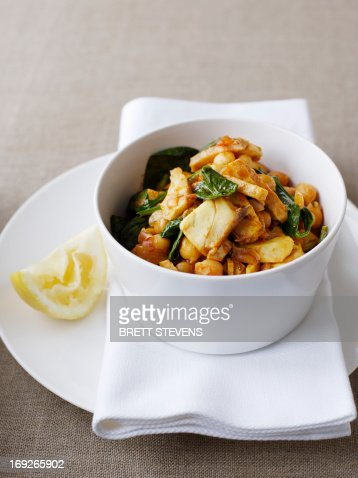 Bowl of stewed meat with herbs : Stock Photo