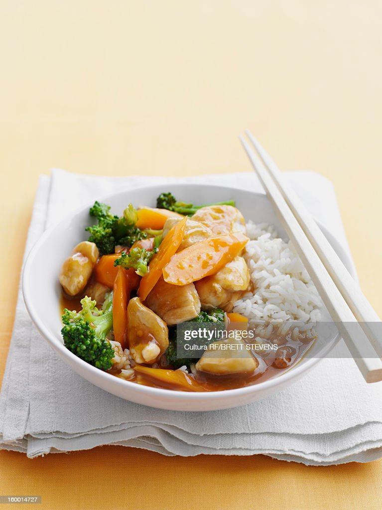 Bowl of sweet and sour chicken with rice : Stock Photo