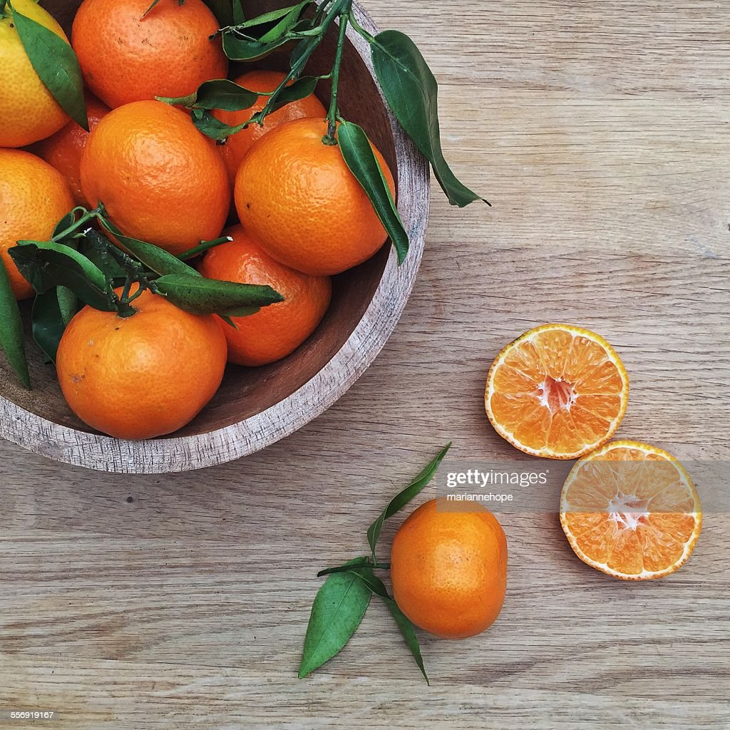 Bowl of Tangerines on a wooden table
