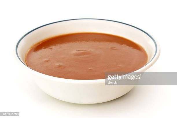 Bowl of tomato soup against a white background
