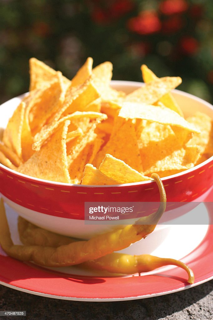 Bowl of tortilla chips with fresh chillis in sunsh : Stock Photo