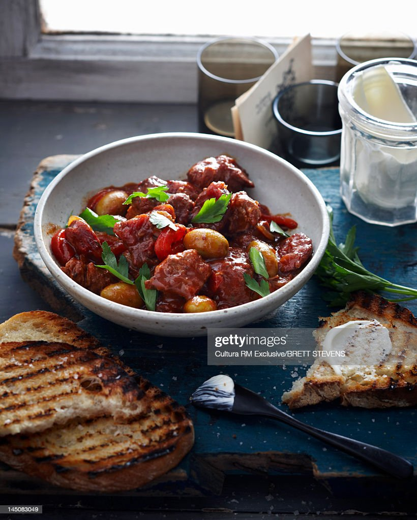 Bowl of vegetables and meat with bread : Stock Photo
