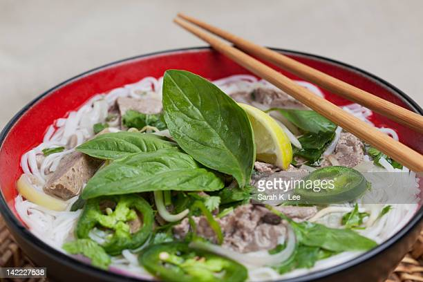 Bowl of Vietnamese pho noodles with beef and herbs