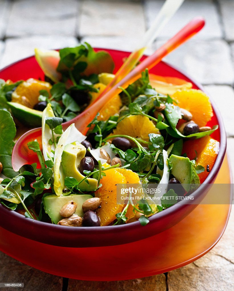 Bowl of watercress salad with orange and almonds