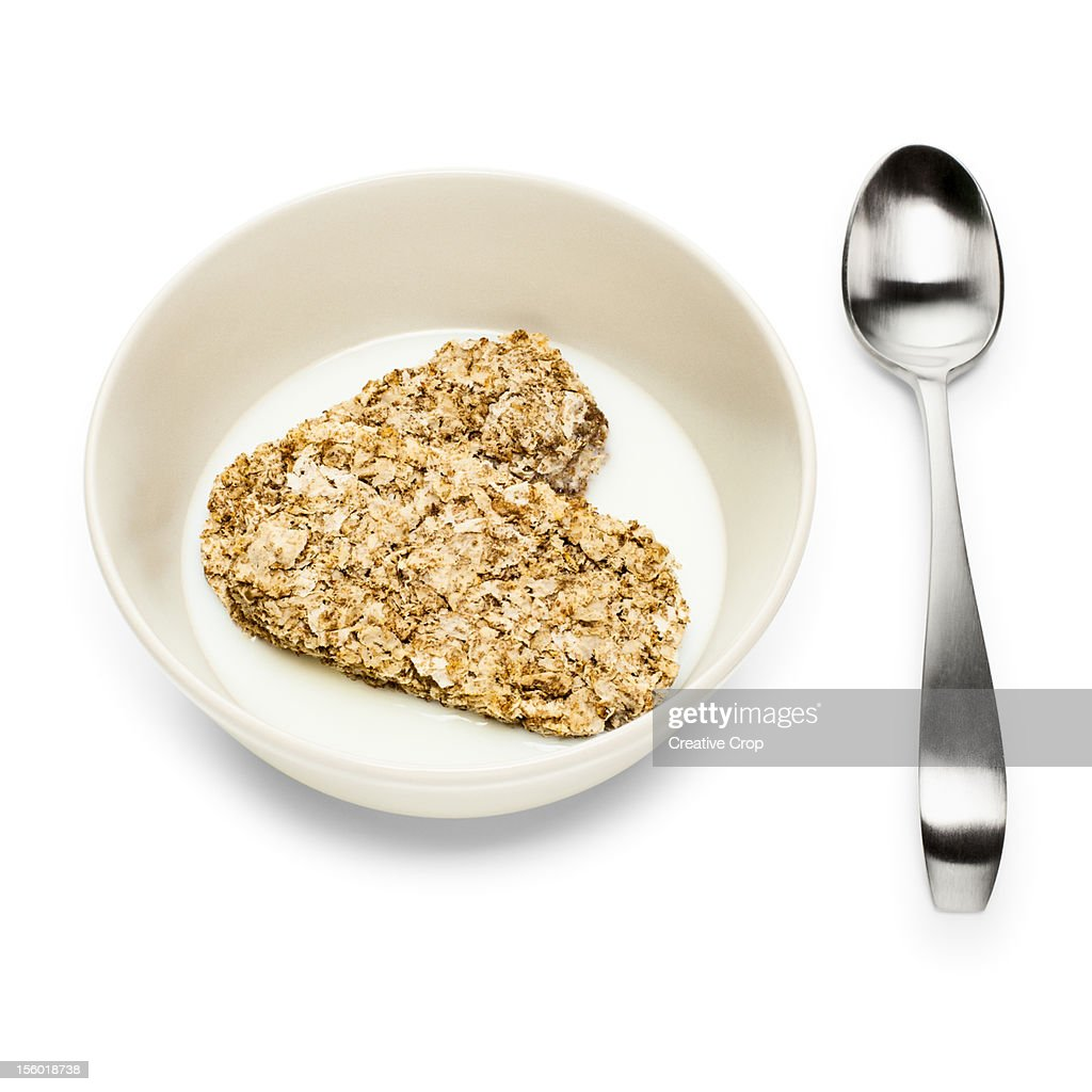 Bowl of wheat cereal and milk with spoon : Stock Photo