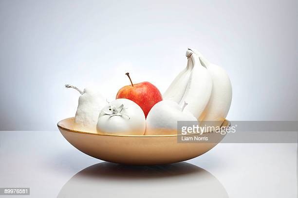 bowl of white fruit with apple