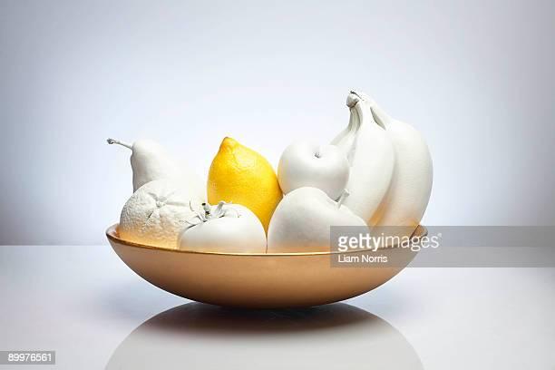 bowl of white fruit with lemon