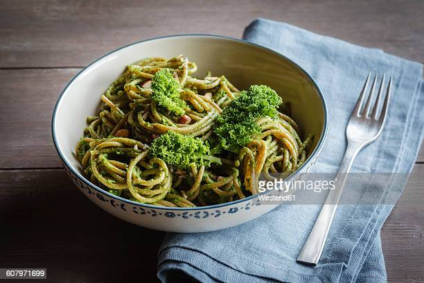 Bowl of whole-grain spelt pasta with kale and hazelnut pesto