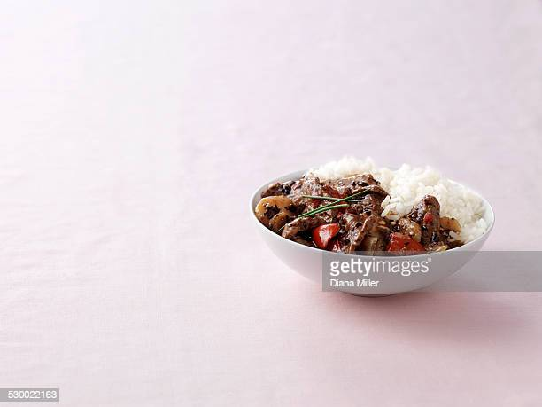 Bowl of wok fried beef in black bean sauce with steamed rice