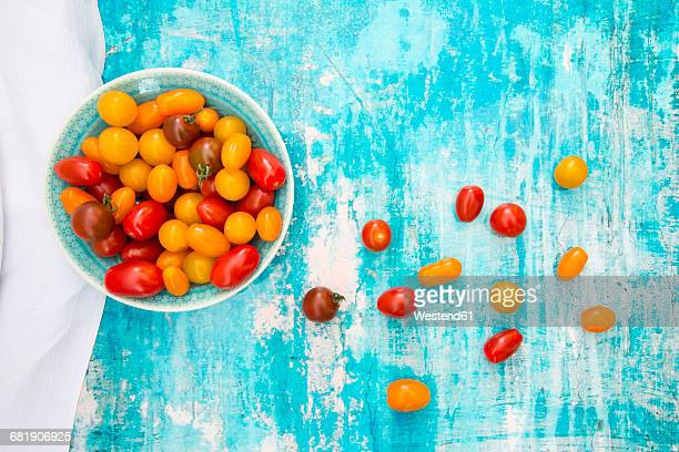 Bowl of yellow and red mini tomatoes