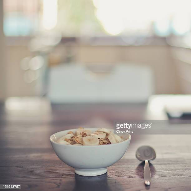 Bowl of yoghurt with cereal and banana