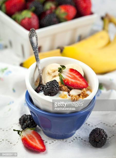 Bowl of yogurt and granola with fresh berries