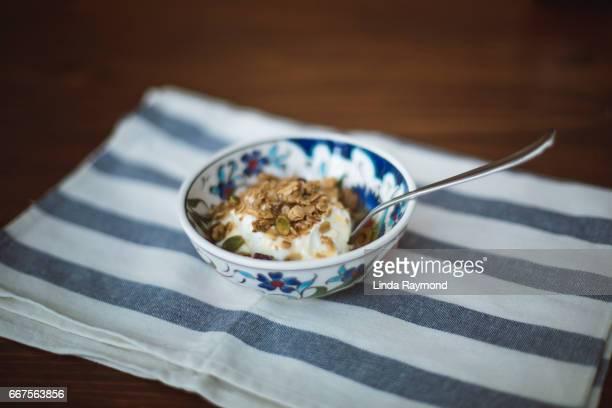 Bowl of yogurt with granola on top
