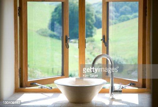 Bowl sink at window in bathroom : ストックフォト