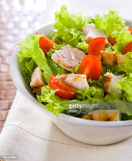 A bowl with chicken and caesar salad
