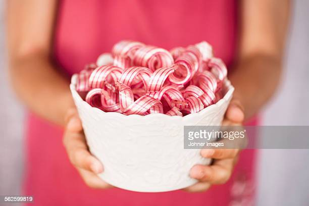 Bowl with curly sweets