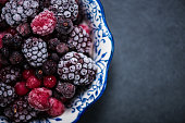 Bowl with frozen black forest fruits mixed