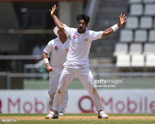 Bowler Hasan Ali of Pakistan celebrates with teammates after taking the wicket of West Indies batsman Shai Hope who was out lbw for 17 on the fifth...