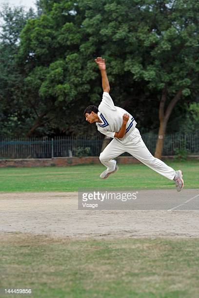 Bowler in action on the field