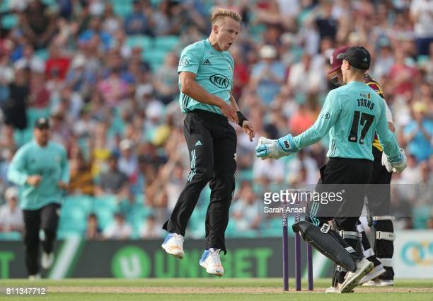 Bowler Tom Curran celebrates with wicket keeper Rory Burns after Surrey win a last ball thriller during the NatWest T20 Blast match at The Kia Oval...