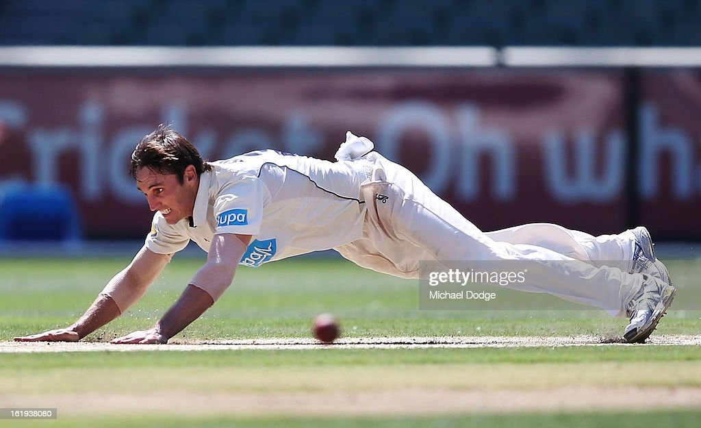 Bowler Will Sheridan of the Bushrangers falls on the pitch after bowling during day one of the Sheffield Shield match between the Victorian Bushrangers and the Queensland Bulls at Melbourne Cricket Ground on February 18, 2013 in Melbourne, Australia.