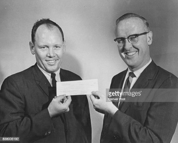Bowling Aids Post Charities Harold Hubbel Jr executive secretary of Denver Metropolitan Bowling Proprietors Association presents check for $120410 to...