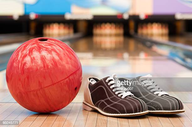Bowling ball and shoes on lane