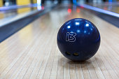 Bowling accessories background. Interior of bowling alley, lane with thirteen kilograms ball closeup, selective focus