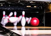 Bowling ball hitting its target.