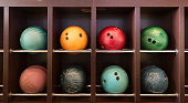 Bowling balls on the wooden shelf