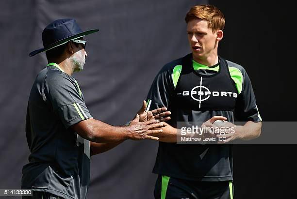 Bowling coach Chaminda Vaas of Ireland talks to Craig Young during a Training Session ahead of the ICC Twenty20 World Cup at HPCA Stadium on March 7...