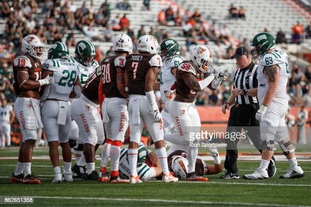 Bowling Green Falcons linebacker Kholbe Coleman celebrates after tackling Ohio Bobcats quarterback Nathan Rourke in the first half of a game between...