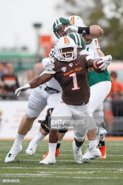 Bowling Green Falcons running back Josh Cleveland tries to break a tackle in the first half of a game between the Ohio Bobcats and the Bowling Green...