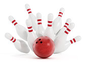 Bowling strike with red balls and bowling pins.