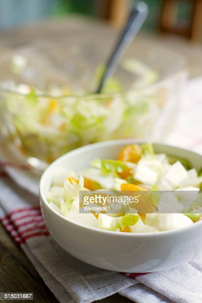 Bowls of Belgian endive salad with mandarin oranges on kitchen towel
